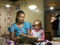 Solar home systems benefits a family in rural communities of Rwanda.