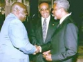 Focus on human rights: Mr. Annan with President Kabila (far left) and OAU Secretary-General Salim Salim