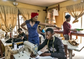 Fashion designer Ejiro A. Tafiri, 28, and her team in their workshop in Lagos, Nigeria. Photo: Panos/A. E.