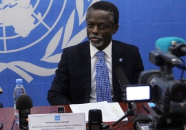 Special Representative and head of the Multidimensional Integrated Stabilization Mission in the Central African Republic (MINUSCA) Parfait Onanga-Anyanga briefs the press after meeting with majority of presidential candidates following first round of elec