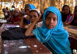 Young girls attend a maths class at a school in Niger's Diffa region, where more than half of the students are Nigerians who have been displaced by fighting. Photo: UNHCR/K. Mahoney