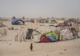A child wanders in the refugee camp of Assaga, near Diffa, Niger. More than 135 displacement sites have been noted along the border with Nigeria, where there has been increased acts of violence conducted by Boko Haram. Photo: UNICEF/Sylvain Cherkaoui