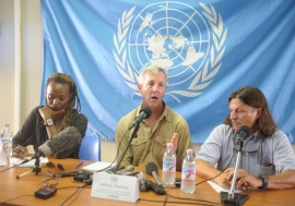 Head of the UN Mission for Ebola Emergency Response (UNMEER) Anthony Banbury (centre) speaks to reporters in Monrovia, Liberia. Photo: UNMIL/Emmanuel Tobey