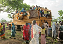 Refugees await unloading at a site in Upper Nile state, South Sudan. Photo: UNHCR/Jake Dinneen