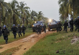 French forces from Opération Licorne (Operation Unicorn) and Jordanian Formed Police Units from the United Nations Operation in Côte d'Ivoire (UNOCI) conduct crowd control exercises near Grand Bassam, Côte d'Ivoire. Opération Licorne works in support of U