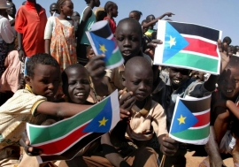 Refugee children prepare to return from Kenya to South Sudan in December 2005, soon after the signing of the Comprehensive Peace Agreement, which led to the nation's independence in 2011. UNHCR/Hélène Caux