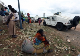 Displaced civilians leave the UNMISS (UN Mission in South Sudan) base in UN House, after seeking refuge at the base in the wake of recent fresh clashes in Juba between soldiers of the Sudan People's Liberation Army (SPLA) and the SPLA in Opposition (SPLA-