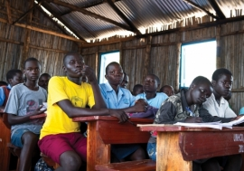 Refugee students in a classroom in Uganda. Photo: UN Photo/Mark Garten