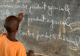 A young Burundian refugee completes an exercise on a blackboard at Jugudi Primary School in Nyarugusu Refugee Camp, Kigoma Province, north-west Tanzania.
