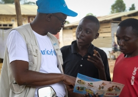 Photo Credits:Thomas Nybo. On 12 September 2018 in Beni, a UNICEF staff member discusses the best way to protect yourself against Ebola in a conversation with young people living in Beni, Democratic Republic of Congo, after a recent Ebola outbreak.