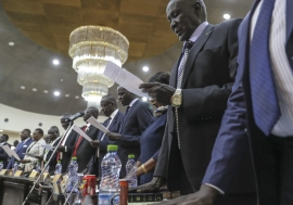 Oath of office in one hand, the other on a Bible or Quran as 35 ministers and ten deputies were sworn into South Sudan's new cabinet on 16 March.