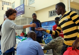 Ethiopian migrants from Tanzania receive onward transportation allowance at IOM's Transit Centre.