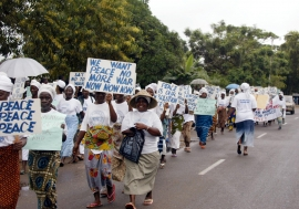 Liberian women marching through the streets of Monrovia agitating for peace.