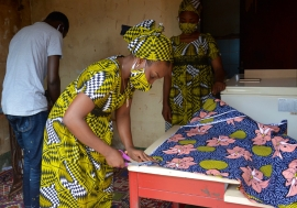 Kinanata Sali Yaya, 27, is an entrepreneur who launched a business fabricating masks along with her sister and brother in response to COVID-19 pandemic in Central African Republic.