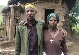 Mrs. Belay with her husband, Priest Leul Hunegnaw, in front of their barn. She says contraception has had a liberating effect.