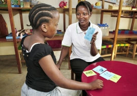 Child with autism spectrum disorder learning to improve her speech and pronunciation in an autism rehabilitation facility in Tanzania.        Panos / Dieter Telemans