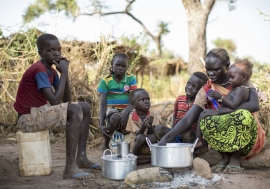 Sudanese refugee Amal Bakith cooks the first breakfast for her children a day after arriving in Ajuong Thok camp, South Sudan. During their long journey from South Kordofan, they had only rotten food to eat. Photo: UNHCR/Rocco Nur