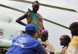 This photo from November 2014 shows IOM providing transportation assistance in South Sudan, moving vulnerable refugees on a UNHCR helicopter. Photo: IOM