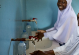 Photo: UNICEF/Kate Holt.  Students in Tanzania enjoy fresh water for drinking, washing and cooking.