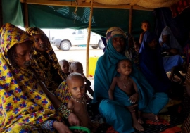 New arrivals from Mali sit inside one of the tents at Mbera Camp, some 50 kilometres inside Mauritania