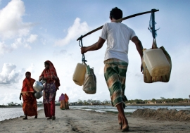 Above, people carry drinking water in Bangladesh