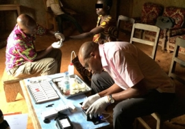 Testing of the mobile phone-based video microscope in Cameroon. Photo: NIAID.