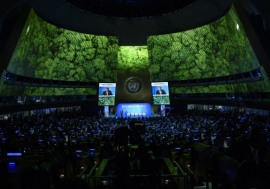 Secretary-General António Guterres (on screens and at podium) opens the UN Climate Action Summit 2019