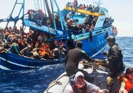 The Italian Navy rescues migrants in the Mediterranean Sea.