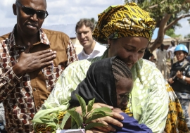 UN Deputy Secretary-General Amina Mohammed hugs a young girl during her visit to South Sudan.
