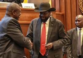 UNMISS/Nektarios Markogiannis. President Salva Kiir (right) of South Sudan shakes hands with leader Riek Machar after concluding a peace deal to end the conflict in the country (September 2018).