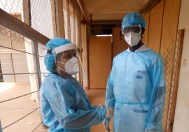 Dr. Babio (left) and Dr. Amoussouvi preparing for the visit of all hospitalized patients.