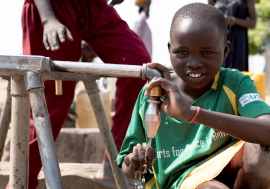 A child having safe drinking water.