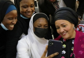UN Deputy Secretary-General Amina Mohammed interacts with young women.