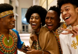 A group of youth laughing.