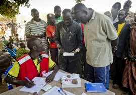 A man and his family register as refugees in Uganda. Photo credit: UNHCR/F. Noy