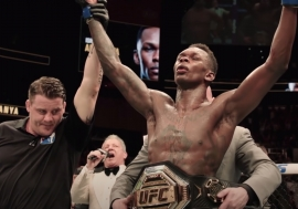Israel Adesanya, with his UFC middleweight world champion belt