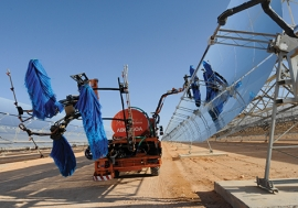 Solar panels being cleaned at the Ain Beni Mathar Integrated Combined Cycle Thermo-Solar Power Plant in Morocco.World Bank/Dana Smillie