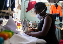A woman at work at a garment manufacturing factory in Harare, Zimbabwe.