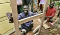 Jonathan Bigirima (left), married and father of six, in his joinery. Photo: Panos/D. Telemans