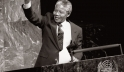 Nelson Mandela, then Deputy President of the African National Congress of South Africa, raises his fist in the air while addressing the Special Committee Against Apartheid in the General Assembly Hall.