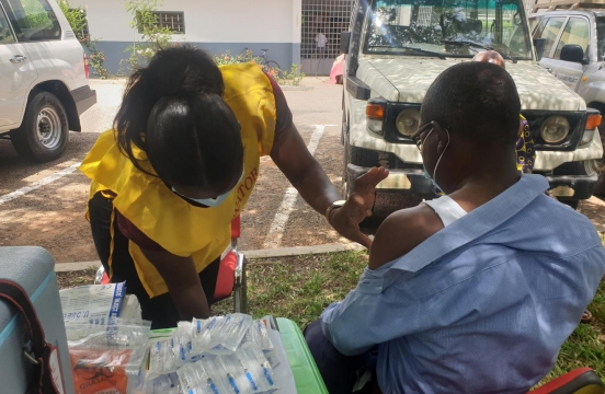 Health worker vaccinating a client in the Kumasi in the Ashanti Region of Ghana