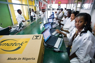 Technicians assemble computers at the Omatek factory in Lagos, Nigeria. Photo: Panos/Sven Torfinn