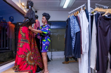 Designer Kiki Cardow adjusting a display at her boutique in Lagos, Nigeria. Panos/ Andrew Esiebo