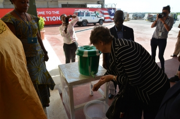 UN Development Program (UNDP) Administrator Helen Clark washes her hands on arrival in Ebola-affected Monrovia, Liberia. Photo: UNDP/Dylan Lowthian