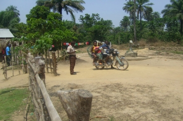 This motorbike has crossed the border from Sarkonedou in Liberia to Koutizou in Guinea. The opening of Liberia's official borders enables economic activities and allows students to attend school. Photo: UNMEER/Kennei Momoh
