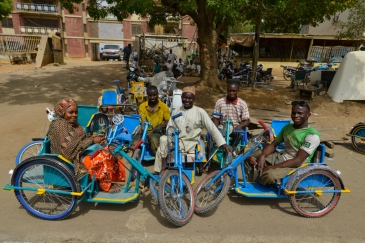 Survivors of polio in Kano State, Nigeria, sit on tricycles specially designed for people with disabilities.