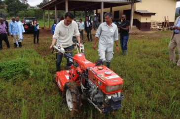 Japan's senior vice-minister of agriculture, forestry and fish eries Taku Eto tries out a Japanese-made tilling machine in Cameroon.  Photo: The Government of Japan