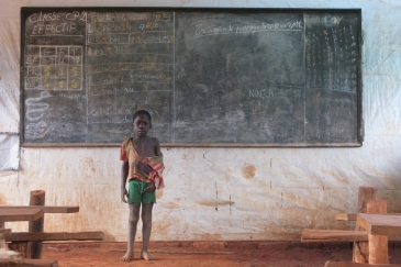 A Congolese refugee at an emergency school in Obo, Haut-Mbomou, Central African Republic, (CAR) after fleeing attacks by the Lord's Resistance Army (LRA). Photo: OCHA/Lauren Paletta