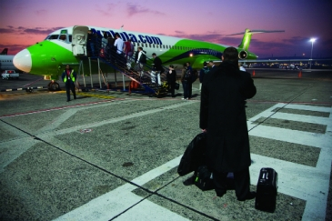 Travellers boarding a Kulula.com jet, South Africa's first budget airline, at Durban International Airport. Photo: AMO/David Larsen