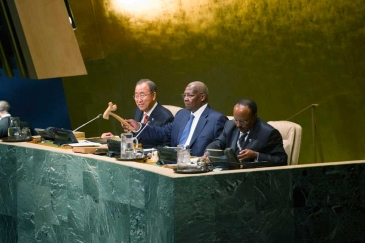 Sam Kahamba Kutesa (centre), President of the sixty-ninth session of the General Assembly, opens the general debate of the session. He is flanked by Secretary-General Ban Ki-moon (left) and Tegegnework Gettu